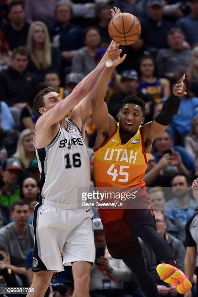Donovan Mitchell of the Utah Jazz passes the ball past Pau Gasol of the San Antonio Spurs in the second half of a NBA game at Vivint Smart Home Arena...