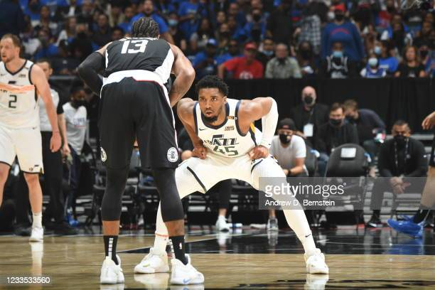 Donovan Mitchell of the Utah Jazz plays defense on Paul George of the LA Clippers during Round 2, Game 6 of the 2021 NBA Playoffs on June 18, 2021 at...