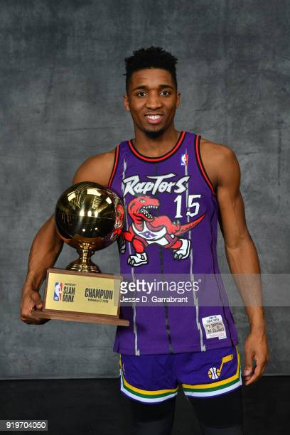 Donovan Mitchell of the Utah Jazz pose for a portrait with the trophy as the winner of the 2018 Verizon Slam Dunk during State Farm AllStar Saturday...