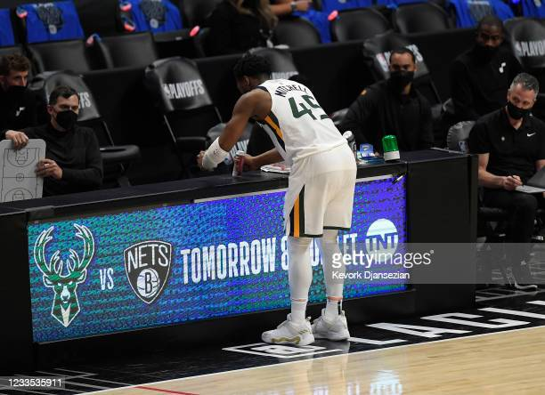 Donovan Mitchell of the Utah Jazz pounds the scorer's table during the closing minute of Game Six of the Western Conference second-round playoff...