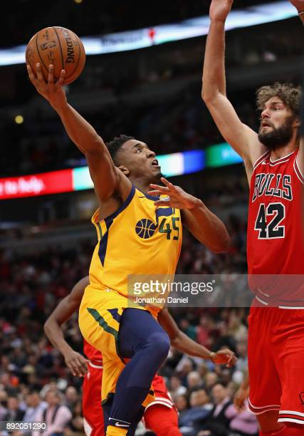 Donovan Mitchell of the Utah Jazz puts up a shot against Robin Lopez of the Chicago Bulls on his way to a gamehigh 32 points at the United Center on...