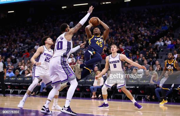 Donovan Mitchell of the Utah Jazz puts up a shot while covered by Willie CauleyStein Bogdan Bogdanovic and Justin Jackson of the Sacramento Kings at...