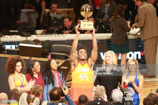 Donovan Mitchell of the Utah Jazz raises the Slam Dunk contest trophy during The 2018 State Farm AllStar Saturday Night at Staples Center on February...