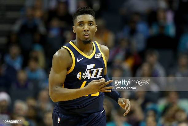 Donovan Mitchell of the Utah Jazz reacts after a play against the Charlotte Hornets during their game at Spectrum Center on November 30 2018 in...