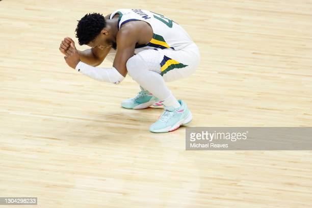 Donovan Mitchell of the Utah Jazz reacts to missing a three pointer against the Miami Heat during the fourth quarter at American Airlines Arena on...