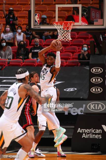Donovan Mitchell of the Utah Jazz rebounds the ball during the game against the Miami Heat on February 26, 2021 at American Airlines Arena in Miami,...
