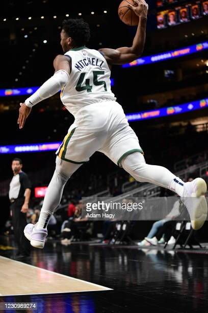 Donovan Mitchell of the Utah Jazz saves the ball against the Atlanta Hawks on February 4, 2021 at State Farm Arena in Atlanta, Georgia. NOTE TO USER:...