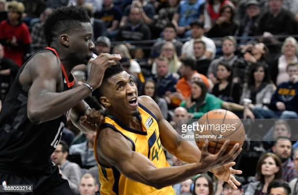 Donovan Mitchell of the Utah Jazz shoots around the defense of Clint Capela of the Houston Rockets in the second half of the 112101 win by the...