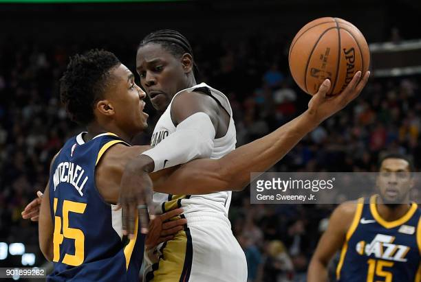 Donovan Mitchell of the Utah Jazz shoots around the defense of Jrue Holiday of the New Orleans Pelicans during their game at Vivint Smart Home Arena...