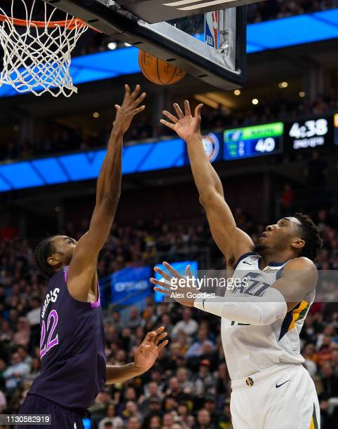 Donovan Mitchell of the Utah Jazz shoots over Andrew Wiggins of the Minnesota Timberwolves during a game at Vivint Smart Home Arena on March 14 2019...