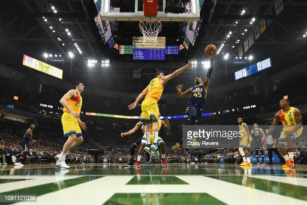 Donovan Mitchell of the Utah Jazz shoots over Brook Lopez of the Milwaukee Bucks during the first half of a game at Fiserv Forum on January 07 2019...