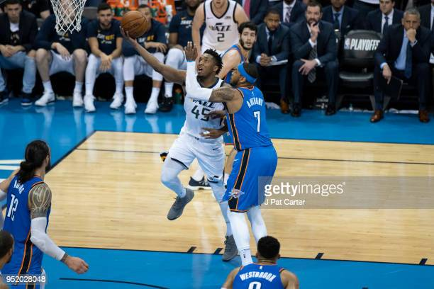 Donovan Mitchell of the Utah Jazz shoots over Carmelo Anthony of the Oklahoma City Thunder during game 5 of the Western Conference playoffs at the...