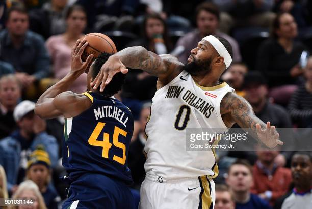 Donovan Mitchell of the Utah Jazz shoots past the defense of DeMarcus Cousins of the New Orleans Pelicans during the second half of the 10898 win by...