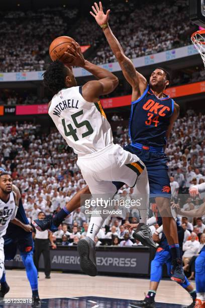 Donovan Mitchell of the Utah Jazz shoots the ball against Josh Huestis of the Oklahoma City Thunder in Game Four of Round One of the 2018 NBA...