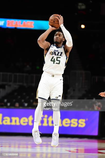 Donovan Mitchell of the Utah Jazz shoots the ball against the Atlanta Hawks on February 4, 2021 at State Farm Arena in Atlanta, Georgia. NOTE TO...