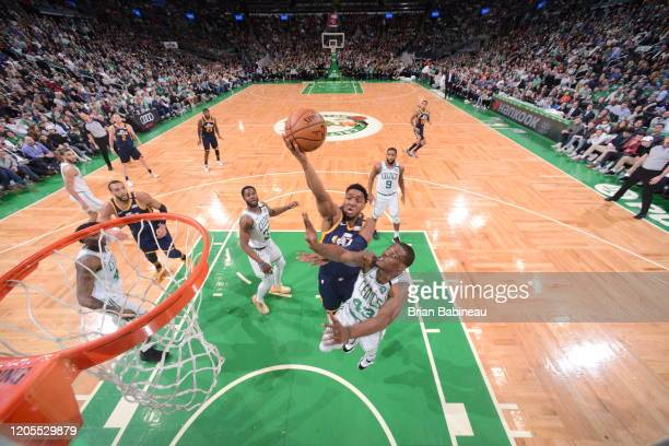 Donovan Mitchell of the Utah Jazz shoots the ball against the Boston Celtics on March 6 2020 at the TD Garden in Boston Massachusetts NOTE TO USER...