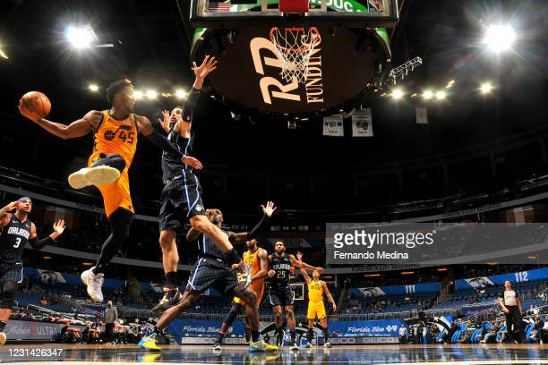 Donovan Mitchell of the Utah Jazz shoots the ball during the game aOrlando Magic on February 27, 2021 at Amway Center in Orlando, Florida. NOTE TO...