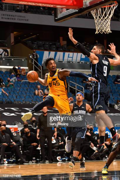 Donovan Mitchell of the Utah Jazz shoots the ball during the game against the Orlando Magic on February 27, 2021 at Amway Center in Orlando, Florida....