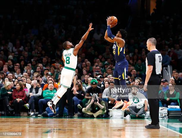 Donovan Mitchell of the Utah Jazz shots over Kemba Walker of the Boston Celtics during the first quarter of the game at TD Garden on March 06 2020 in...