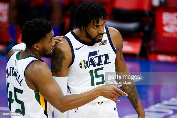 Donovan Mitchell of the Utah Jazz speaks with Derrick Favors during the third quarter against the Philadelphia 76ers at Wells Fargo Center on March...