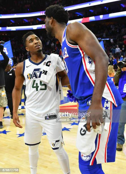Donovan Mitchell of the Utah Jazz speaks with Joel Embiid of the Philadelphia 76ers after the game at Wells Fargo Center on November 20 2017 in...