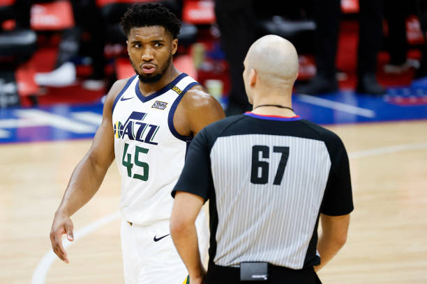 Donovan Mitchell of the Utah Jazz speaks with referee Brandon Adair during the fourth quarter at Wells Fargo Center on March 03, 2021 in...
