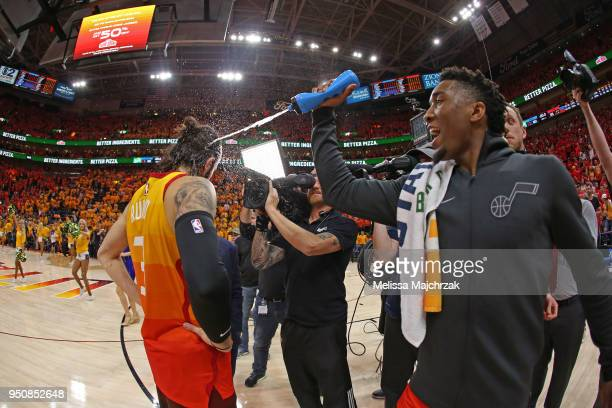 Donovan Mitchell of the Utah Jazz sprays Ricky Rubio of the Utah Jazz with water after Game Three of Round One of the 2018 NBA Playoffs against the...