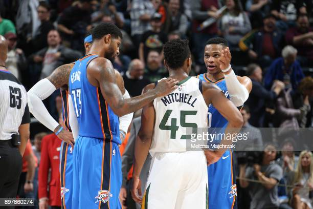 Donovan Mitchell of the Utah Jazz talks with Russell Westbrook Carmelo Anthony and Paul George of the Oklahoma City Thunder after the game on...