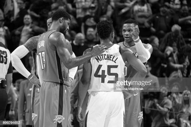 Image has been converted to black and white Donovan Mitchell of the Utah Jazz talks with Russell Westbrook Carmelo Anthony and Paul George of the...