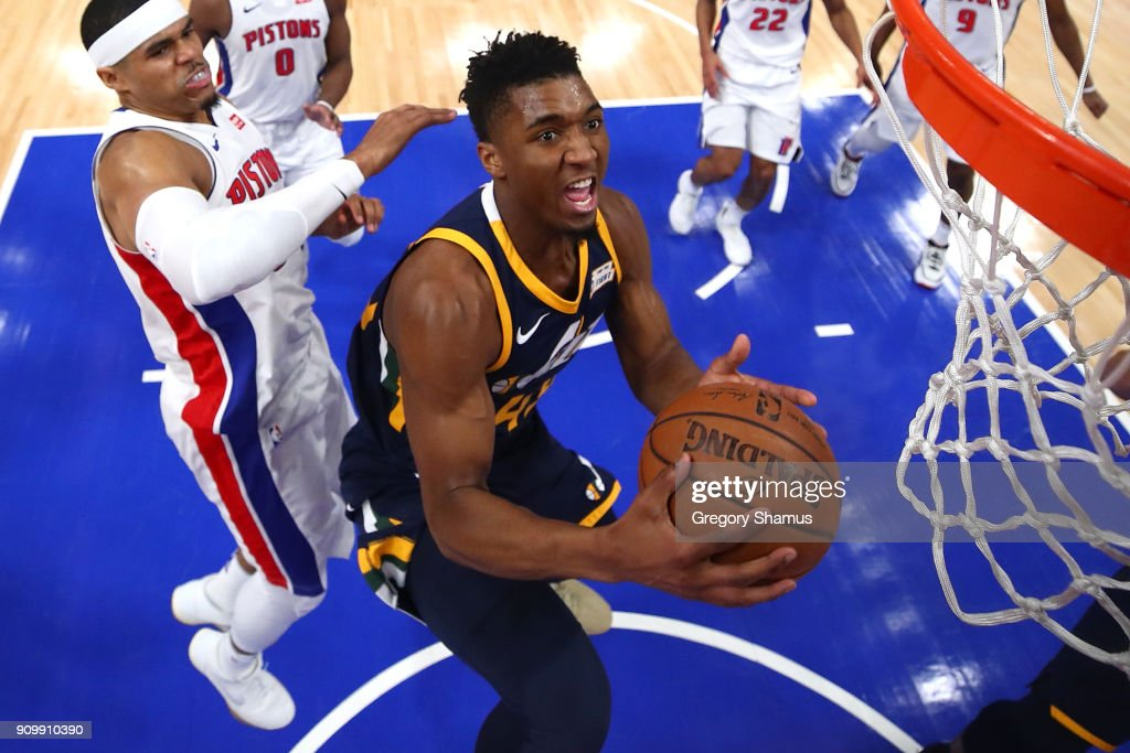 Donovan Mitchell #45 of the Utah Jazz tries to get a shot off past Tobias Harris #34 of the Detroit Pistons during the first half at Little Caesars Arena on January 24, 2018 in Detroit, Michigan. Utah won the game 98-95 in overtime.