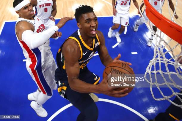 Donovan Mitchell of the Utah Jazz tries to get a shot off past Tobias Harris of the Detroit Pistons during the first half at Little Caesars Arena on...