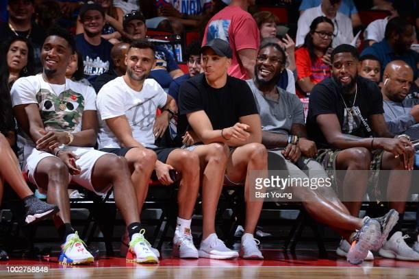 Donovan Mitchell Raul Neto Dante Exum Jae Crowder enjoy the game between the the Utah Jazz and New York Knicks during the 2018 Las Vegas Summer...