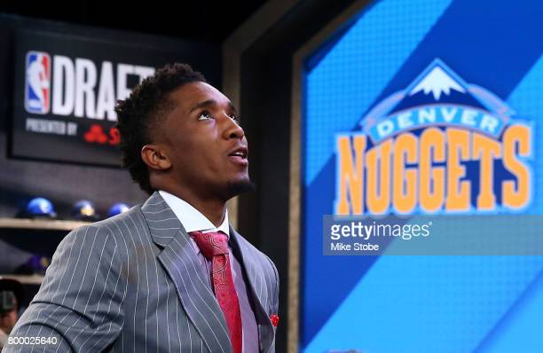 Donovan Mitchell walks to stage after being drafted 13th overall by the Denver Nuggetsduring the first round of the 2017 NBA Draft at Barclays Center...
