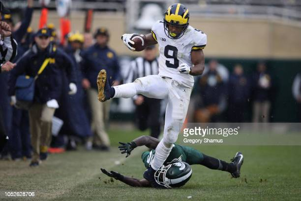 Donovan PeoplesJones of the Michigan Wolverines catches a second half touchdown and avoids the tackle of Tre Person the Michigan State Spartans at...