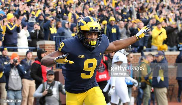 Donovan PeoplesJones of the Michigan Wolverines celebrates after catching a second quarter touchdown pass during the game against the Penn State...
