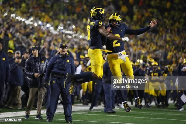 Donovan PeoplesJones of the Michigan Wolverines celebrates his second half touchdown catch with Shea Patterson in front of head coach Jim Harbaugh...