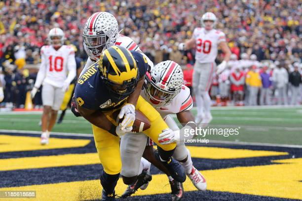Donovan PeoplesJones of the Michigan Wolverines drops the ball in the end zone during the second quarter of the game as Jordan Fuller of the Ohio...
