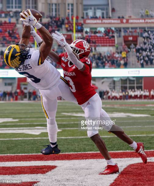 Donovan PeoplesJones of the Michigan Wolverines goes up for a touchdown reception as Tiawan Mullen of the Indiana Hoosiers defends during the first...