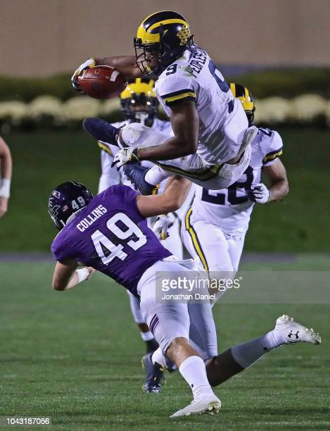 Donovan PeoplesJones of the Michigan Wolverines is flipped in the air on a punt return by Jake Collins of the Northwestern Wildcats at Ryan Field on...