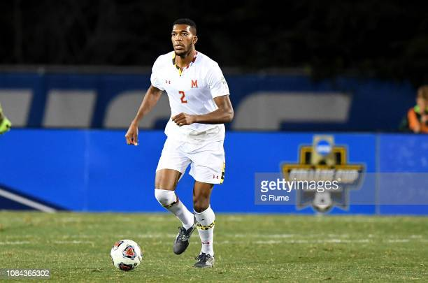 Donovan Pines of the Maryland Terrapins brings the ball up the field against the Akron Zips during the Division I Men's Soccer Championship held at...