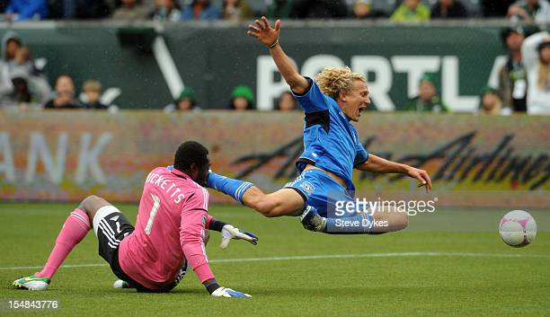 Donovan Ricketts of Portland Timbers and Steven Lenhart of San Jose Earthquakes go after a ball during the first half of the game at JeldWen Field on...