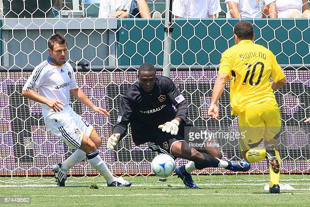 Donovan Ricketts of the Los Angeles Galaxy stops a shot by Alejandro Moreno of the Columbus Crew during their MLS game at The Home Depot Center on...