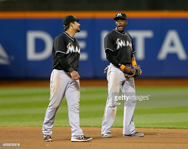 Donovan Solano and Adeiny Hechavarria of the Miami Marlins celebrate the win over the New York Mets on September 15 2014 at Citi Field in the...