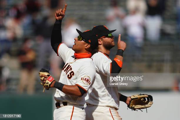 Donovan Solano and Brandon Crawford of the San Francisco Giants celebrate beating the Colorado Rockies at Oracle Park on April 11, 2021 in San...