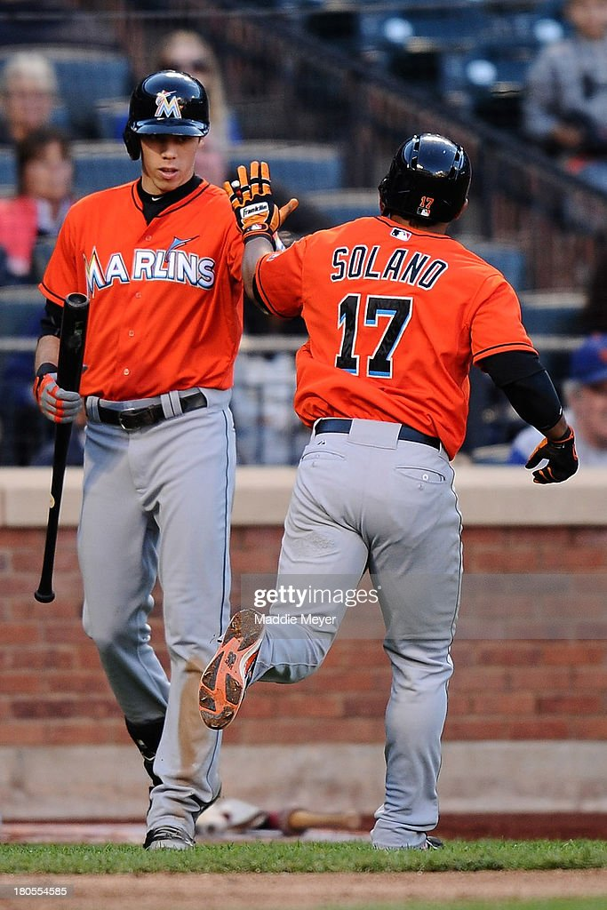 Donovan Solano #17 of the Miami Marlins celebrates his home run with teammate Christian Yelich #21 during the sixth inning against the New York Mets at Citi Field on September 14, 2013 in the Flushing neighborhood of the Queens borough of New York City.
