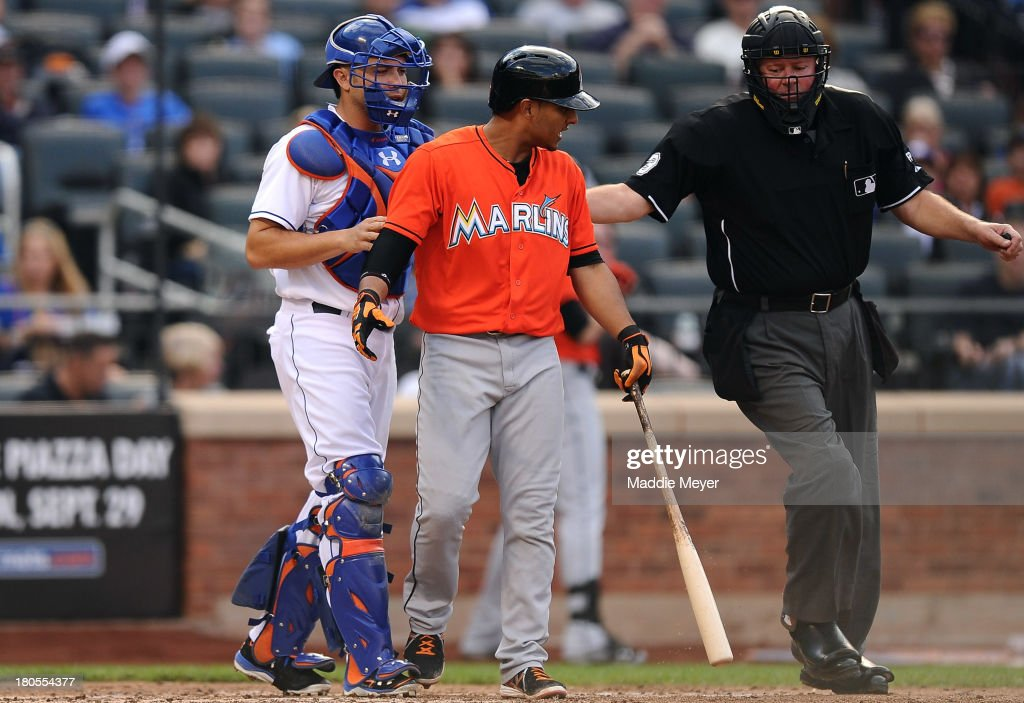 Donovan Solano #17 of the Miami Marlins walks to first base after being hit by a ball in the fourth inning against the New York Mets at Citi Field on September 14, 2013 in the Flushing neighborhood of the Queens borough of New York City.