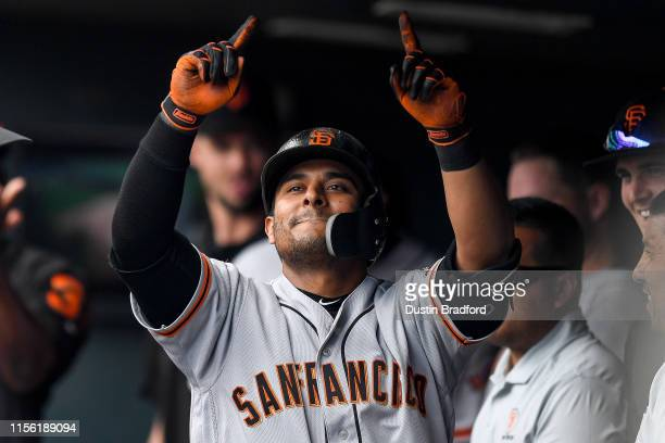 Donovan Solano of the San Francisco Giants celebrates a sixth inning solo homer against the Colorado Rockies at Coors Field on July 17 2019 in Denver...