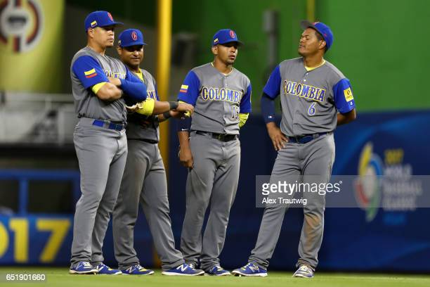 Donovan Solano Reynaldo Rodriguez Adrian Sanchez and Giovanny Urshela of Team Colombia look on during a pitching change during Game 2 Pool C of the...