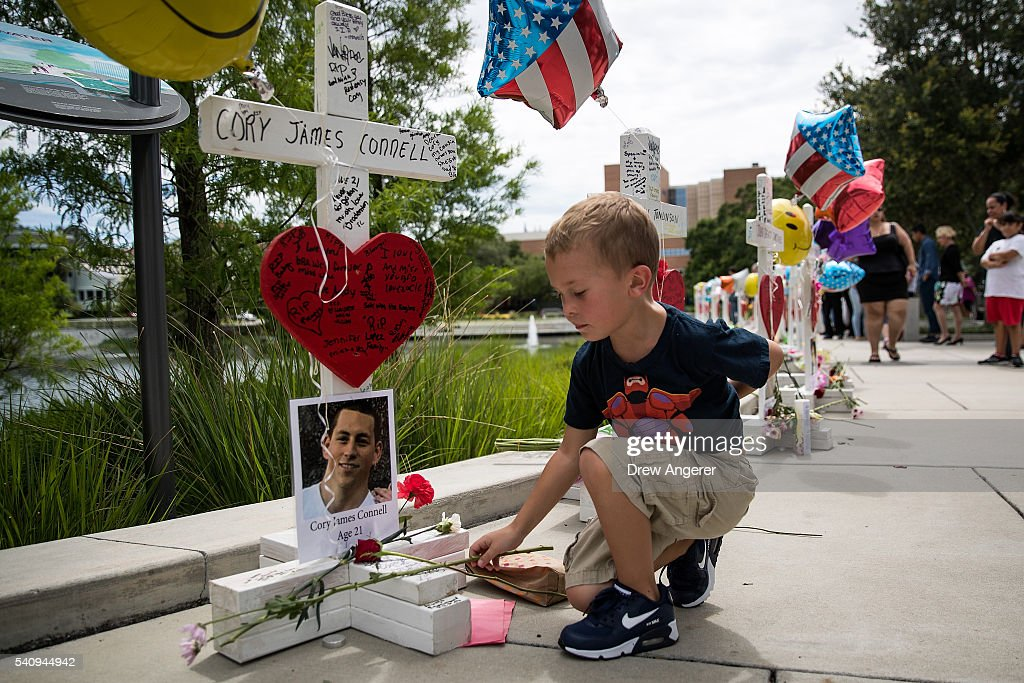 Donovan Spurlock, 7, places flowers at each of the wooden crosses that were made for the 49 victims of the Pulse Nightclub shooting, next to the Orlando Regional Medical Center, June 17, 2016 in Orlando, Florida. The shooting at Pulse Nightclub, which killed 49 people and injured 53, is the worst mass-shooting event in American history.