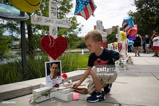 Donovan Spurlock places flowers at each of the wooden crosses that were made for the 49 victims of the Pulse Nightclub shooting next to the Orlando...